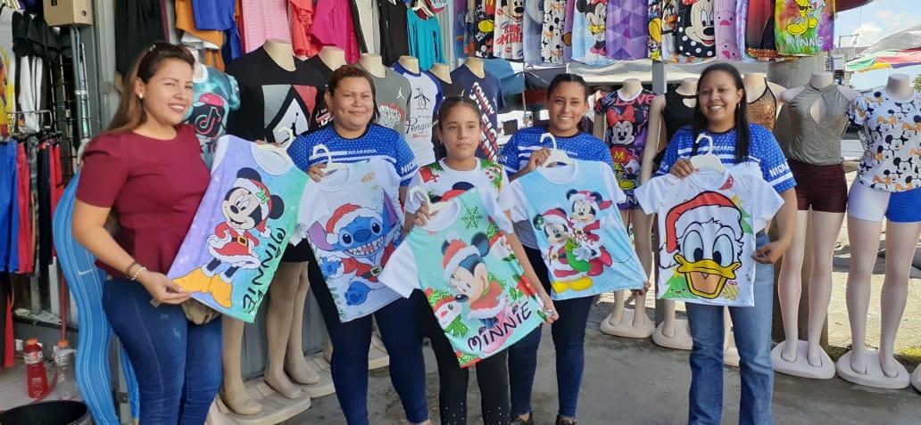 Camisetas sublimadas con diseños navideños, son un nuevo atractivo en los mercados